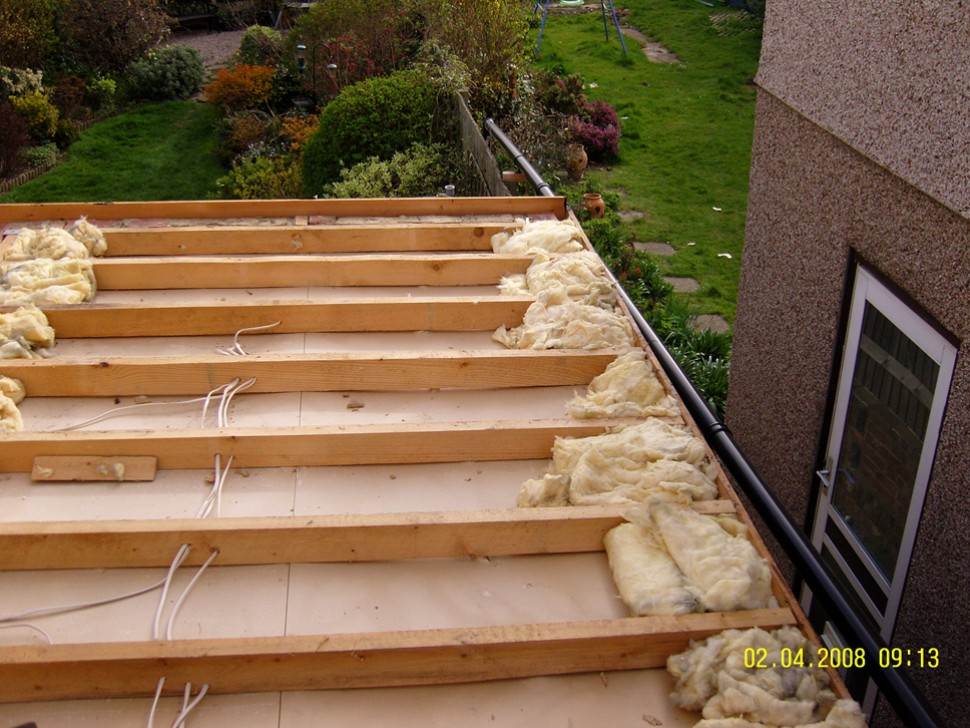 A Flat Roof Removed Insulation Around Edges Used As A
